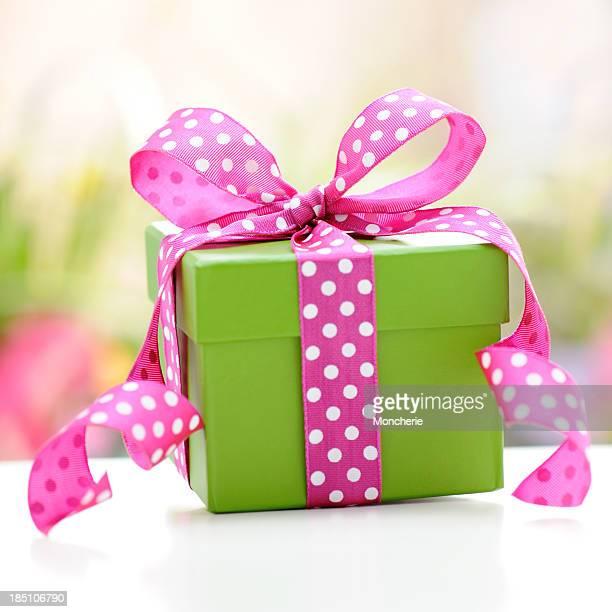 Green gift box with pink ribbon