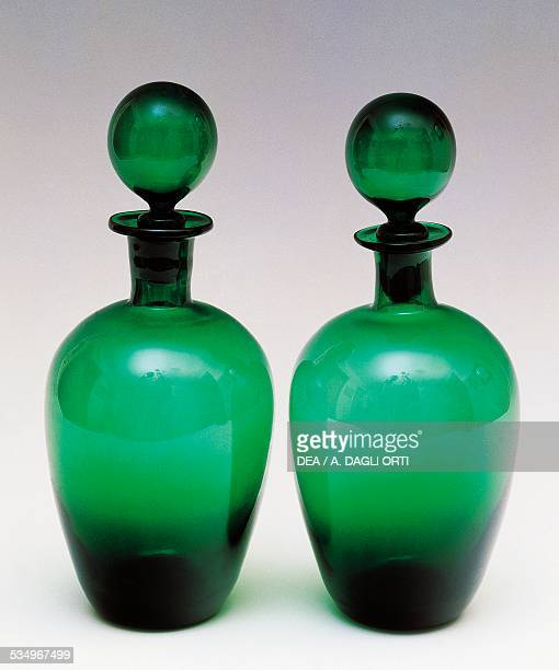 Green glass bottles with ball stopper, early 1960s, Empoli production. Italy, 20th century.