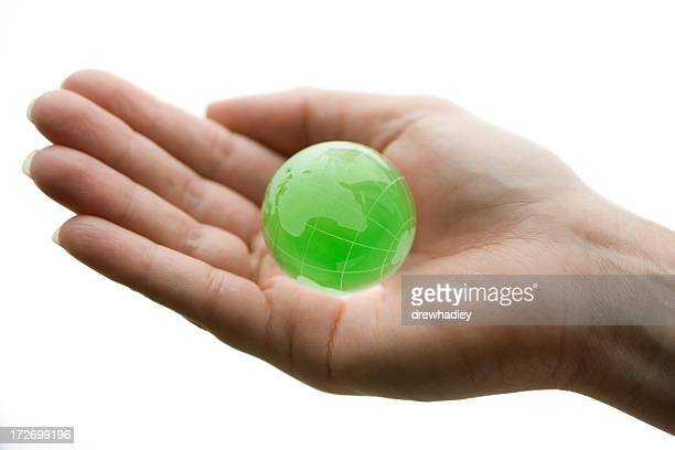 Green Glass World Globe in hand