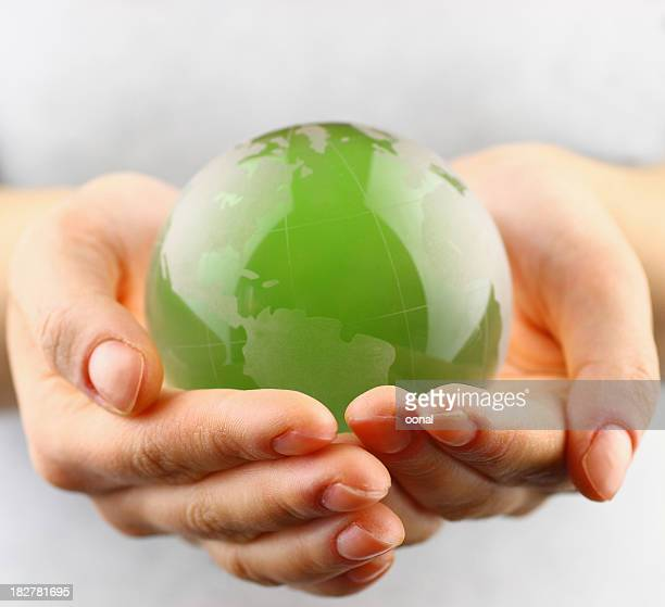 green globe in  hands - climate stock pictures, royalty-free photos & images
