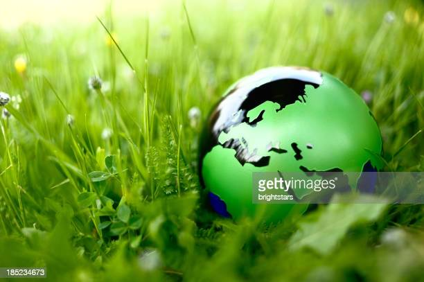 green globe in nature - earth day stock pictures, royalty-free photos & images