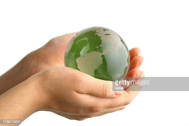 Green globe in the hand