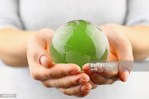 green globe in the hand - global village stock pictures, royalty-free photos & images