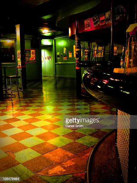 Green glow inside a nightclub.
