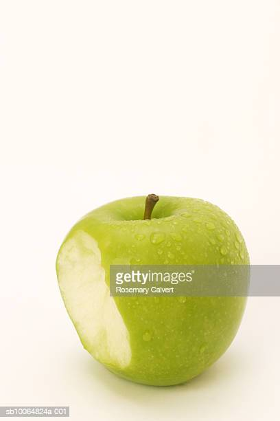 Green Granny Smith apple with water drops, white background