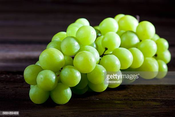 green grape on wood - white grape stock photos and pictures