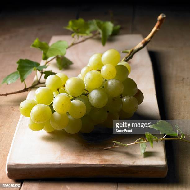 Green grapes on a wooden board