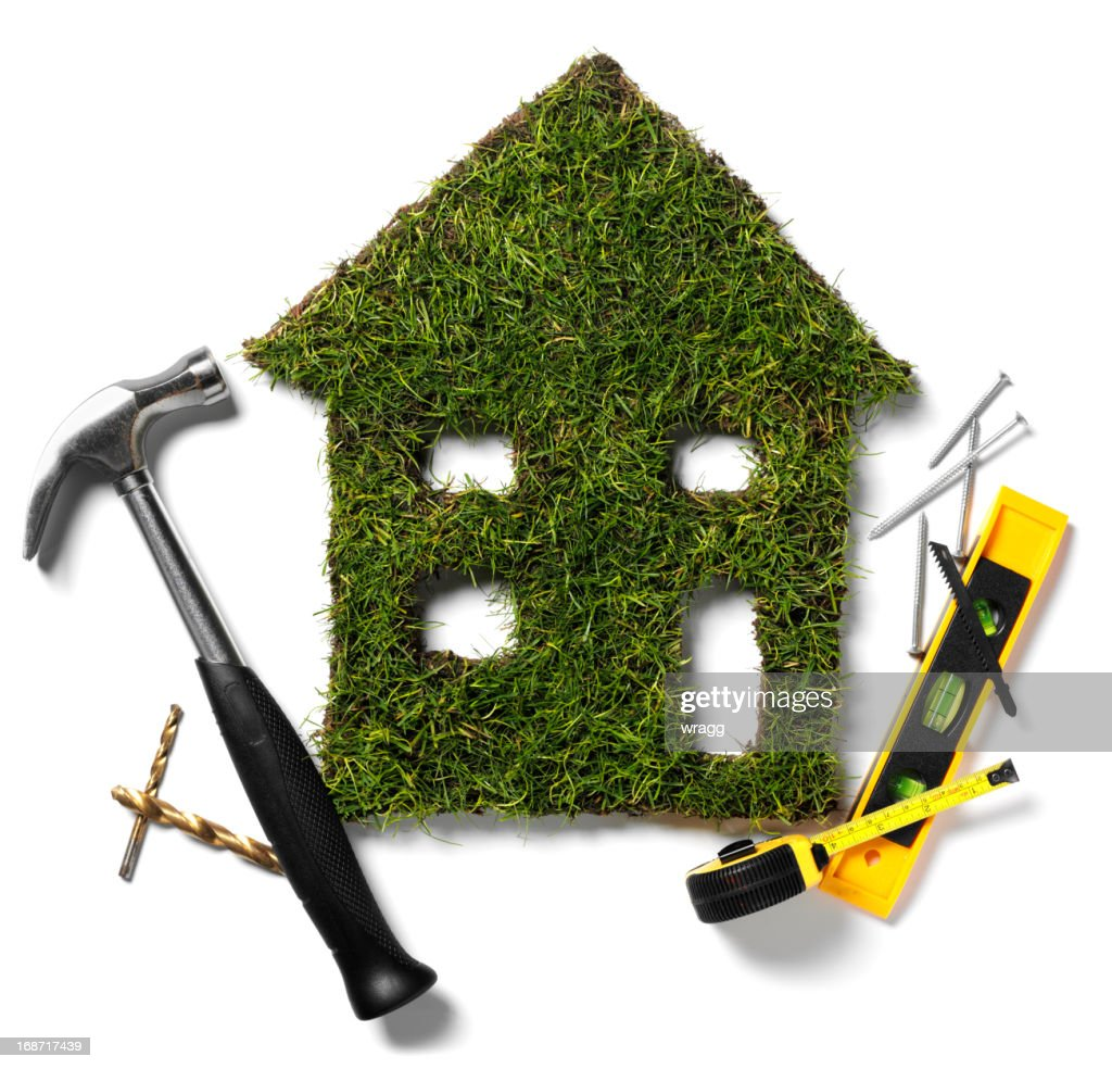 Green Grass House and Tools : Stock Photo