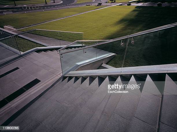 green grass with concrete and glass stairway. - veiligheidshek stockfoto's en -beelden