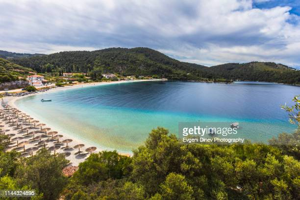 green greek island bay - greek islands stock pictures, royalty-free photos & images