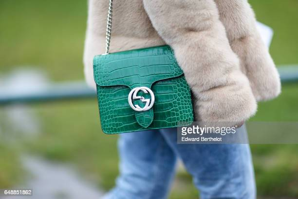 A green Gucci crocodile leather bag is seen outside the Hermes show during Paris Fashion Week Womenswear Fall/Winter 2017/2018 on March 6 2017 in...
