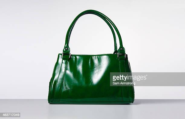 green handbag - clutch bag stock pictures, royalty-free photos & images
