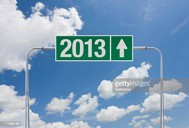 Green highway sign with exit for 2013