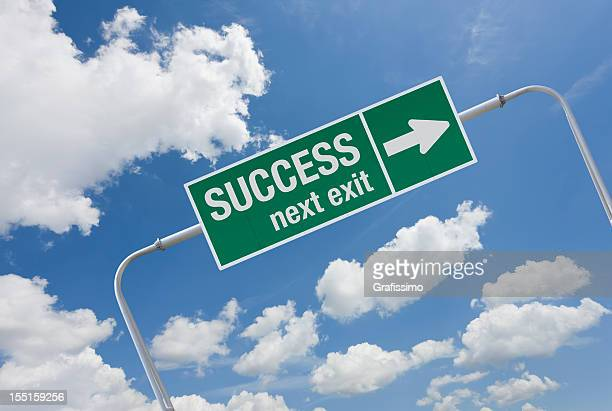 Green highway sign with exit for success