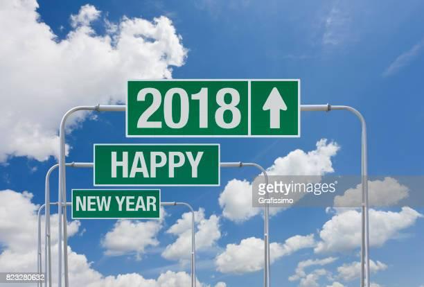 Route verte signe avec sortie pour dire 2018 an Happy New Year