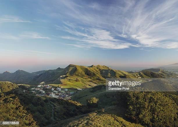 green hills, forest, village and blue sky - paisaje fotografías e imágenes de stock