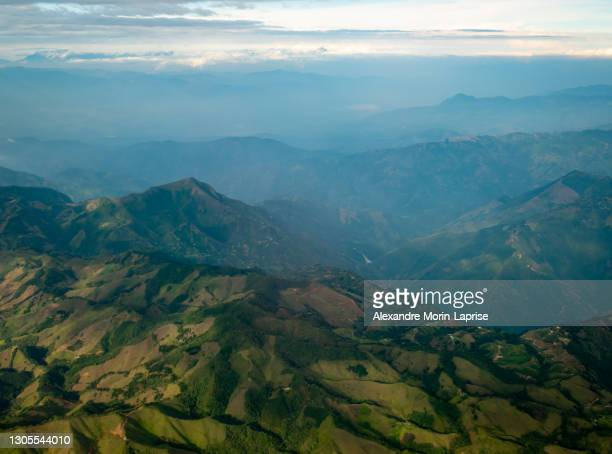 green hills full of pasture for cattle and crop fields in the mountains in bogota, colombia - south america stock pictures, royalty-free photos & images