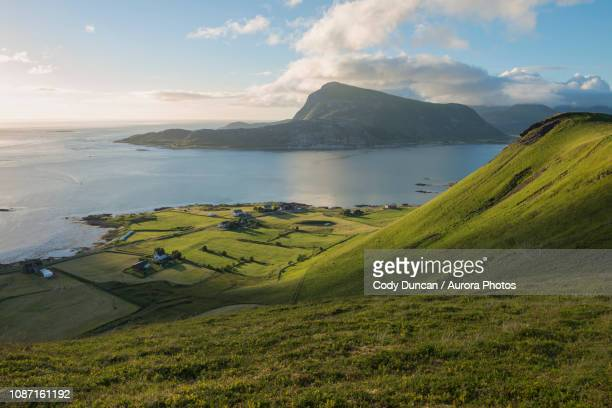 green hillsides of vestvagoya from haugheia, lofoten islands, norway - hill stock pictures, royalty-free photos & images
