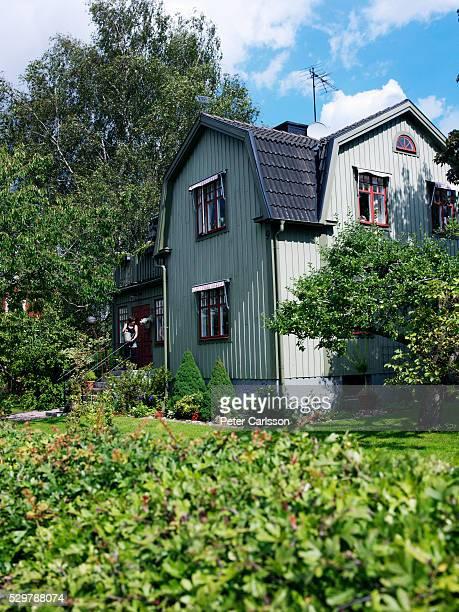 A green house in a sunny garden, Sweden