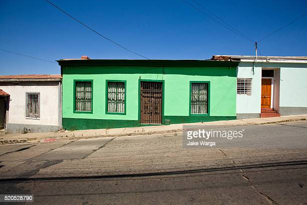 green house on steep hill, valparaiso, chile - jake warga stock pictures, royalty-free photos & images