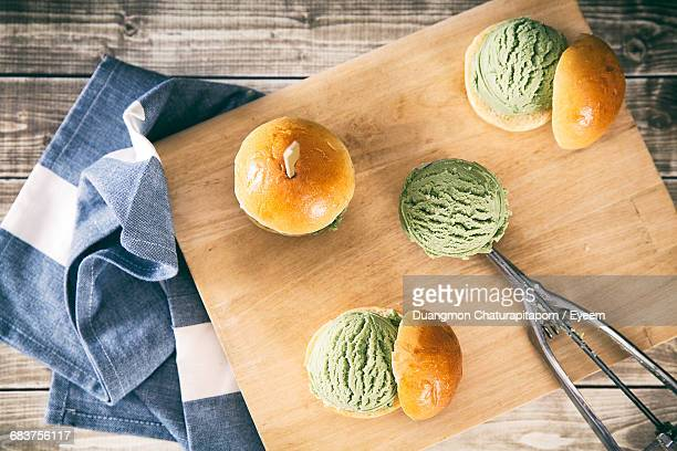 Green Ice Cream With Bread On Wooden Cutting Board