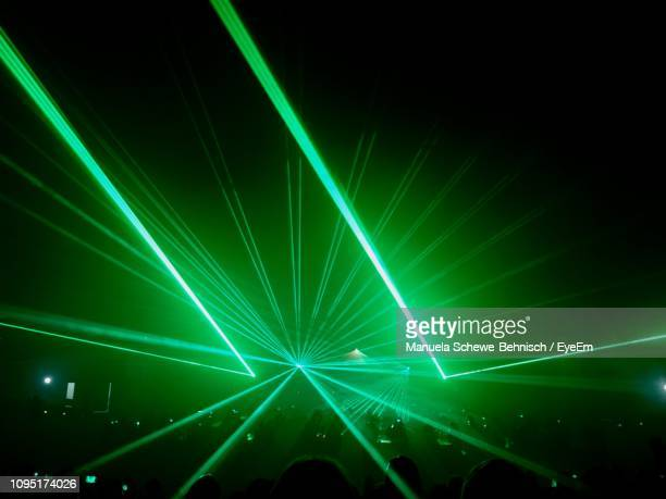 green illuminated light beams in darkroom - laser stock pictures, royalty-free photos & images