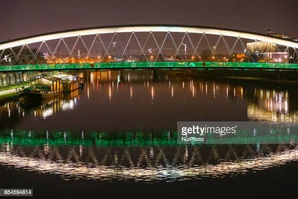 Green illumination on St Patrick's Day of Kladka Bernatka footbridge over Vistula river in Krakow, Poland on 17 March, 2017. Poland joined the Global...