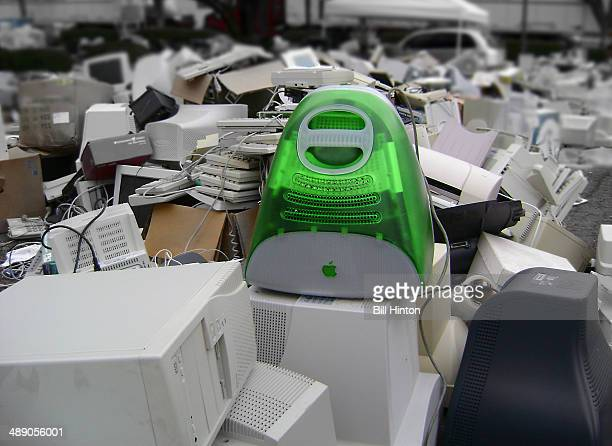 Green iMac atop discarded computers
