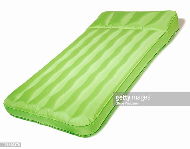 A green inflatable air mattress for sleep or pool