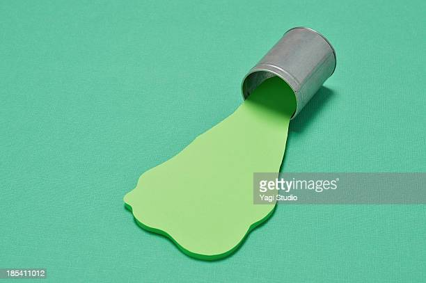 Green ink Spilling out from the can