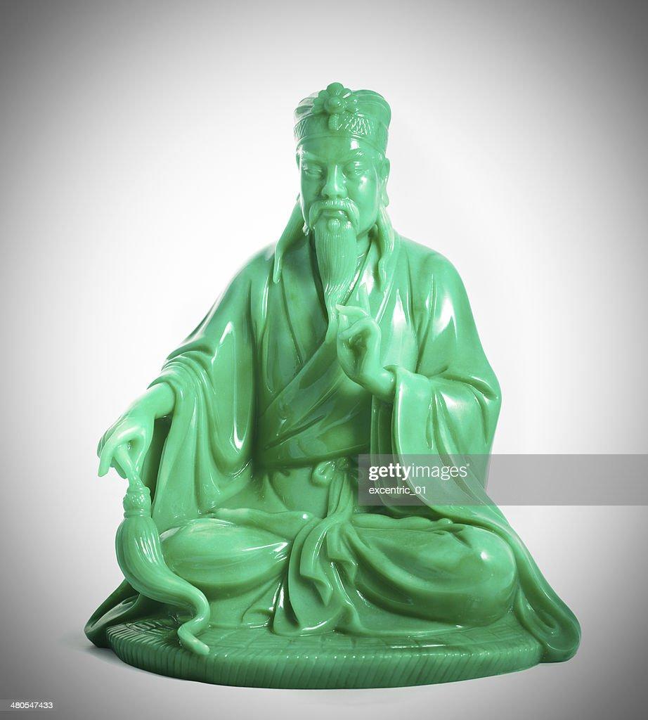 green jade buddha isolated on a white background : Stock Photo