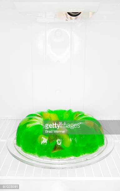 green jello mold in refridgerator - gelatin dessert stock photos and pictures