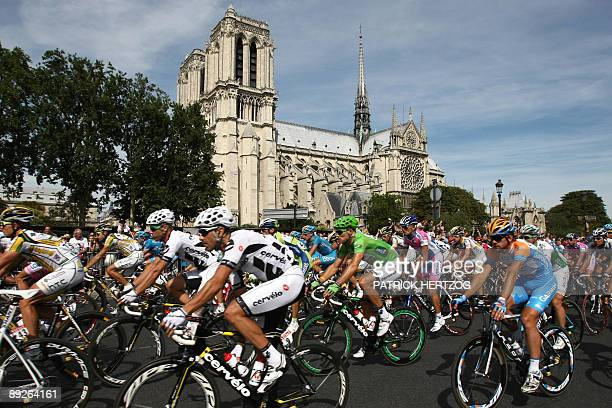 Green jersey of best sprinter Swiss cycling team Cervelo 's Thor Hushovd of Norway rides past Notre Dame de Paris cathedral on July 26 2009 in Paris...