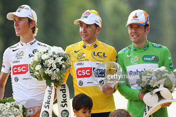Green Jersey Points winner Oscar Freire of Spain and Rabobank ,Yellow Jersey overall race winner Carlos Sastre of Spain and Team CSC Saxobank and...
