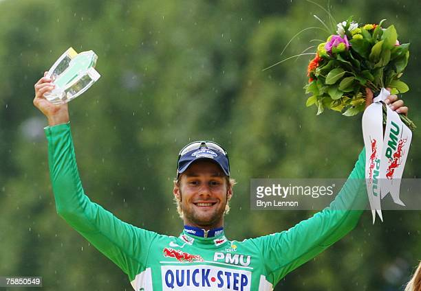 Green Jersey Points winner Tom Boonen of Belgium and Quick Step celebrates on the podium after Stage Twenty of the Tour de France on July 29, 2007 in...
