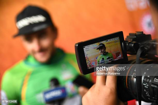 Green jersey winner Robert Muller of ETW Embrace the World Cycling Germany is interviewed during stage 9 of the Tour de Singkarak 2017...
