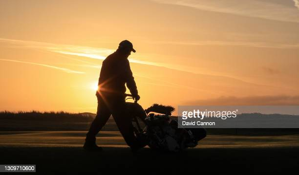 Green keeper cuts the practice putting green as the sun rises as golf returned at Royal St. George's Golf Club on March 29, 2021 in Sandwich,...