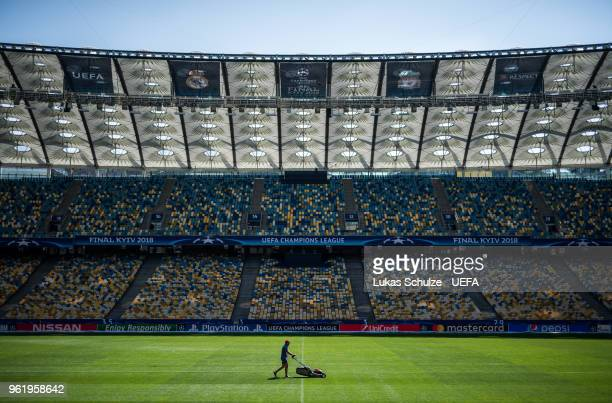A green keeper works on the pitch of the NSC Olimpiyskiy stadium prior to the UEFA Champions League final between Real Madrid and Liverpool on May 24...