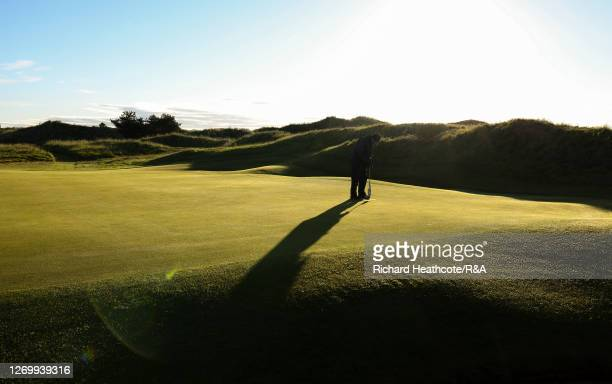 Green keepers work on the 7th green during the final of The Amateur Championship at Royal Birkdale on August 30, 2020 in Southport, England.