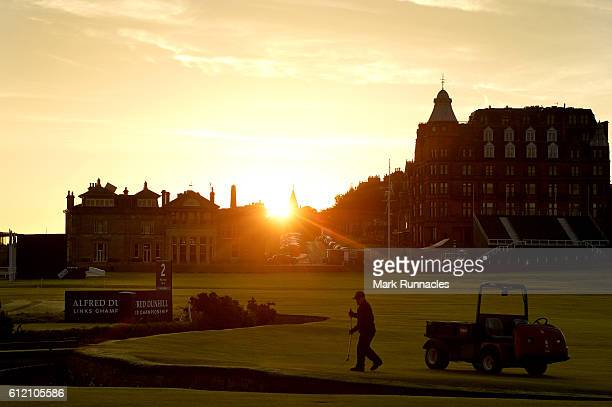 Green keeping staff prepair the Old Course as dawn breaks in St Andrews ahead of the Alfred Dunhill Links Championship at The Old Course on October 3...