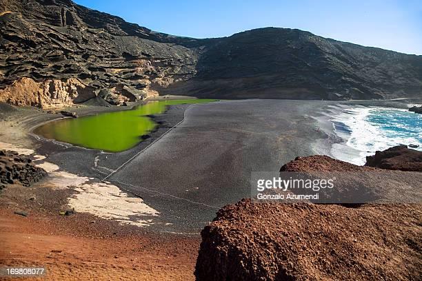 green laggon at el golfo village in lanzarote. - lanzarote stock pictures, royalty-free photos & images