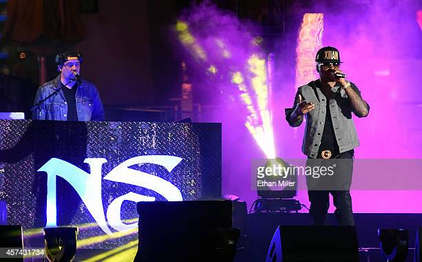 Green Lantern and rapper Nas perform at The Boulevard Pool at The Cosmopolitan of Las Vegas on October 17 2014 in Las Vegas Nevada