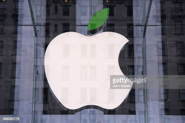 A green leaf adorns the Apple logo on Earth Day at the company's Fifth Avenue store in Midtown Manhattan on April 22 2014 in New York City The store...