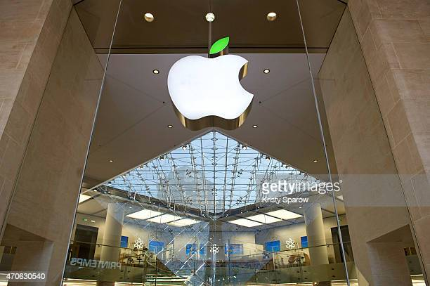 A green leaf is displayed on the Apple logo during 'Earth Day' at the Apple Store Carrousel du Louvre on April 22 2015 in Paris France