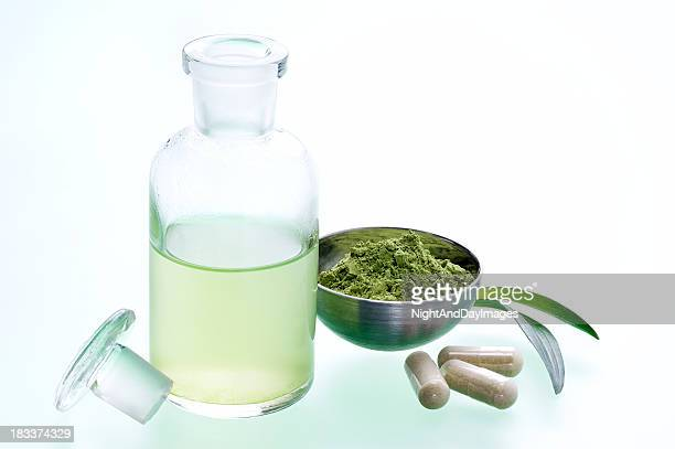 A green leafy natural medicine and its juice on table