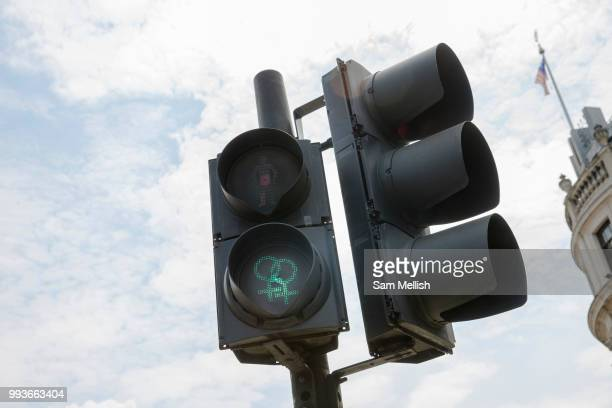 A green light at a pedestrian crossing at Trafalgar Square has been changed to show two icons of the female sex joined together on the 5th July 2018...