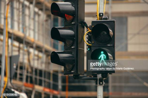 green light for pedestrians - road signal stock pictures, royalty-free photos & images