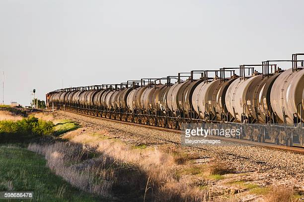 green light for train with clean energy biofuel - cargo train stock photos and pictures
