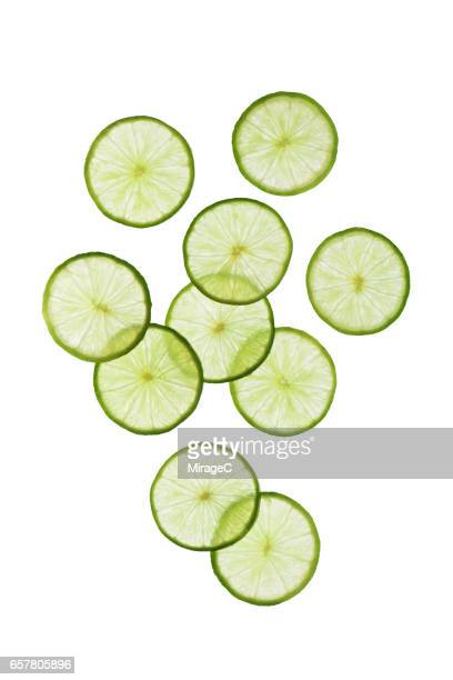 Green Lime Slices on White Background