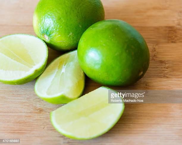 Green limesrealistic approach to food ingredientsLmes are common and popular in the Latin Amercan cuisine here they are shown over wooden background...